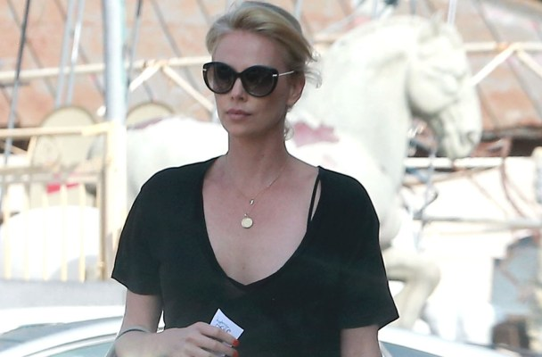 "Exclusive... 51830277 ""The Huntsman"" star Charlize Theron enjoys a sushi lunch at Sugarfish restaurant in Los Angeles, California on August 21, 2015. Rumors are circulating online that Charlize's character Furiosa from ""Mad Max: Fury Road"" may get her own spinoff film after the critical and commercial success of the previous one. FameFlynet, Inc - Beverly Hills, CA, USA - +1 (818) 307-4813"