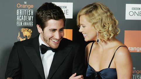 LONDON - FEBRUARY 19:  (Winners results not for publication in any medium until 21:01 GMT February 19, 2006) Actor Jake Gyllenhaal winner of Actor in a Supporting Role for 'Brokeback Mountain' and presenter Charlize Theron (R) pose backstage in the Awards Room at The Orange British Academy Film Awards (BAFTAs) at the Odeon Leicester Square on February 19, 2006 in London, England.  (Photo by Gareth Cattermole/Getty Images)