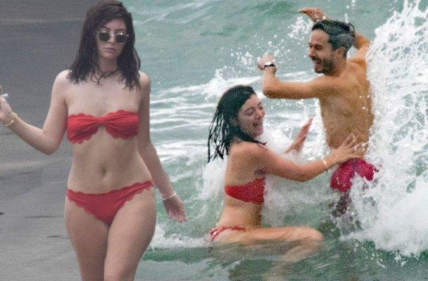 lorede bikini topless beach flirting photos