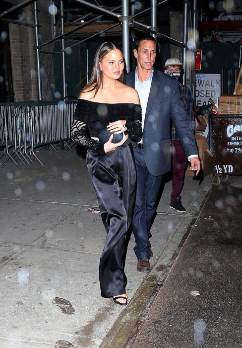 EXCLUSIVE: Chrissy Teigen pictured leaving a restaurant with friends last night in New York City.