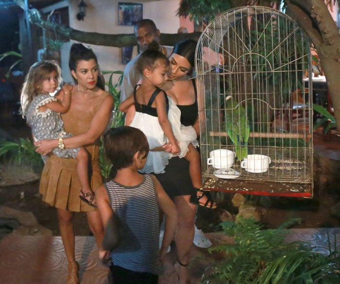 EXCLUSIVE: **PREMIUM EXCLUSIVE RATES APPLY** Kim Kardashian and Kourtney Kardashian show their children a parrot as they ate their last meal together in Cuba