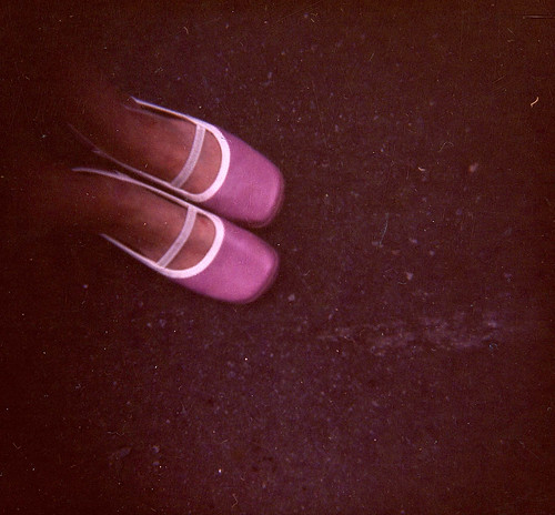 Ghostly feet in pink shoes