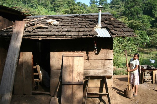 Typical Nicaraguan House, with girl grinding fresh coffee beans, Datanli Diablo Reserve