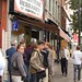 Ishir waits in line for some of Schwartz's famous smoked meat