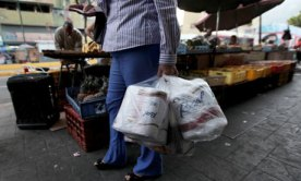 A woman with bags of toilet paper in Caracas