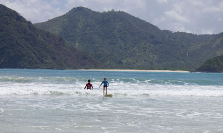 Zac learning to surf, Indonesia