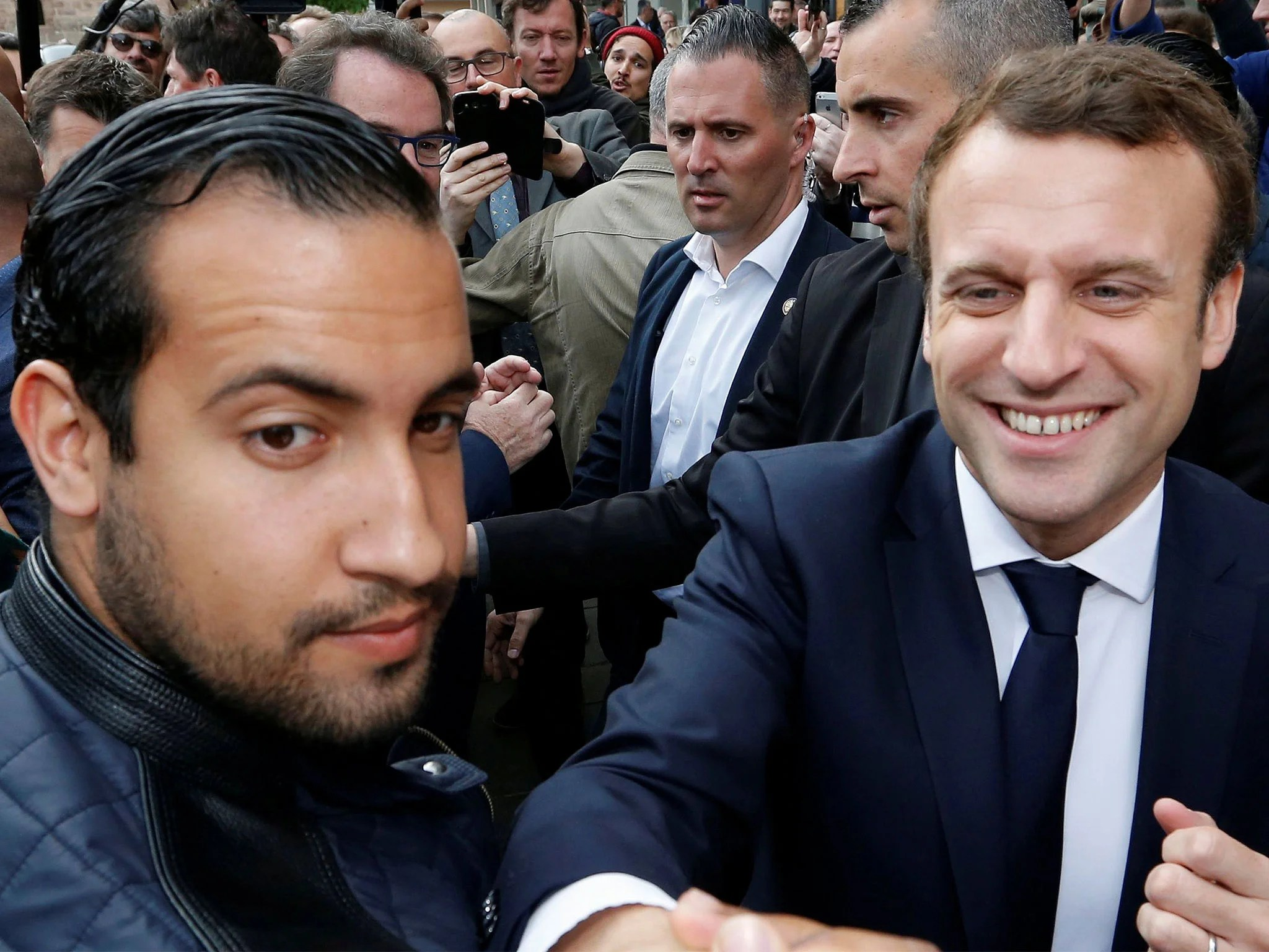 If Macron s bodyguard is attacking anti government protesters     Alexandre Benalla  left  has been charged with a range of offences for  beating up