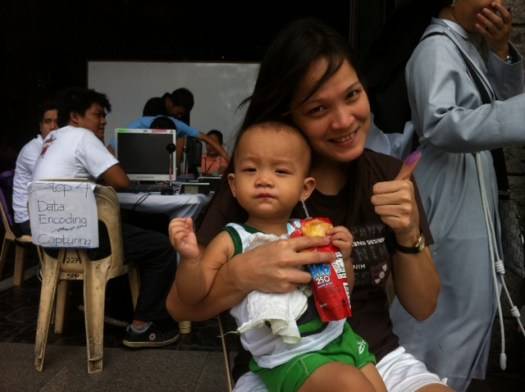 FIRST TIME TO VOTE. Azel Christensen, a deaf person, will vote for the first time and for the sake of her son. Photo by Voltaire Tupaz