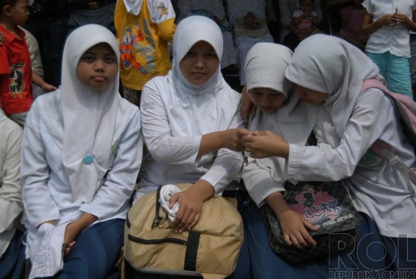 Pelajar berjilbab.