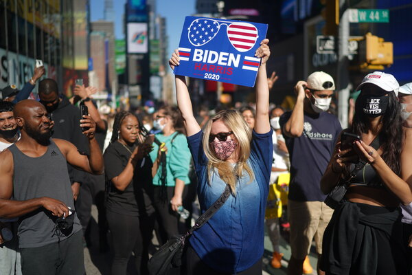 Supporters of President-elect Biden celebrated in New York on Saturday.
