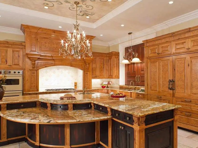 5 kitchens, including this one with custom cabinetry and custom chandelier.
