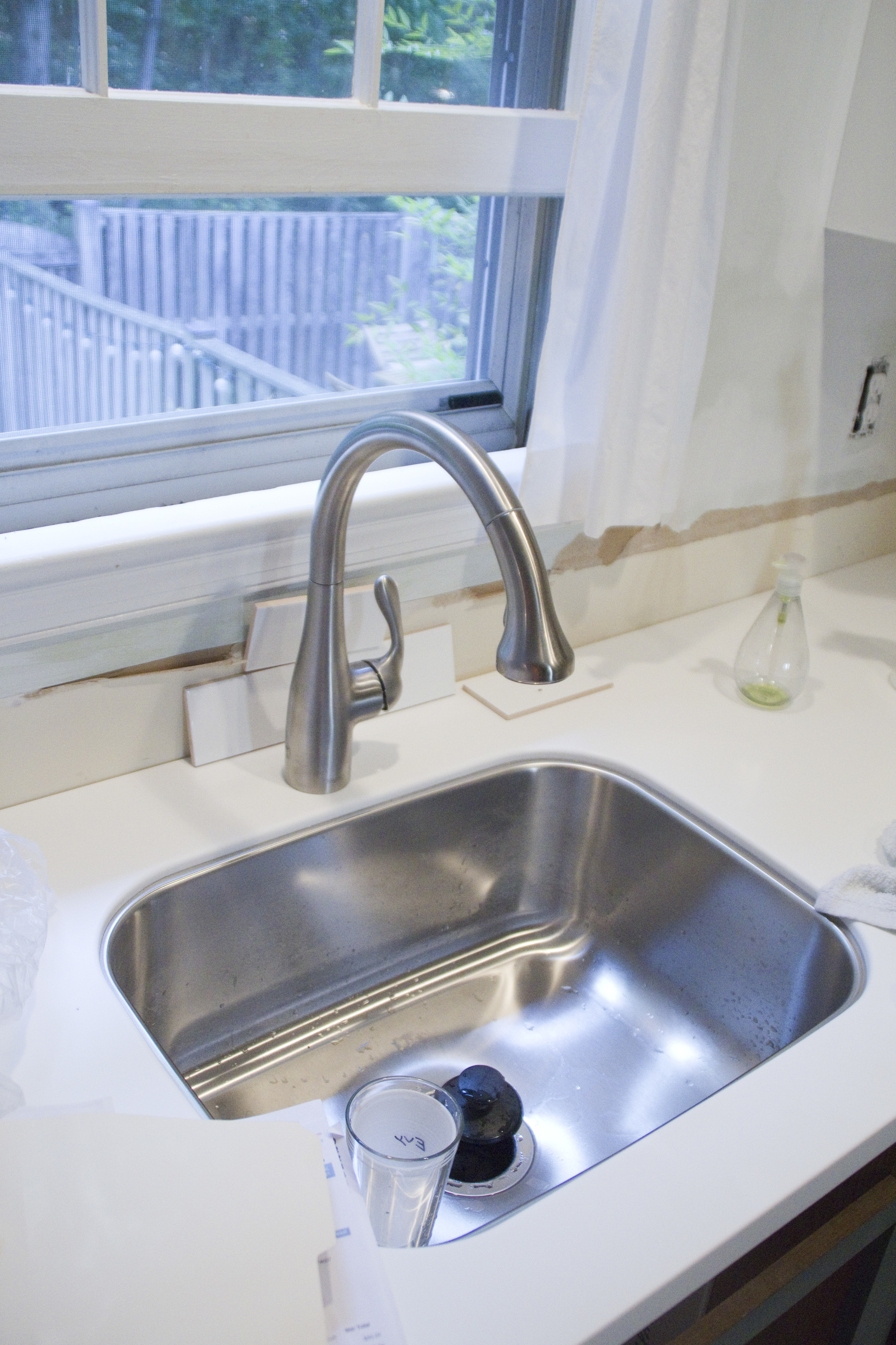 offset costco kitchen faucet While my dad was working on these we had friends come help us sand our drawer fronts and prime our cabinet bases It was so amazing to have help