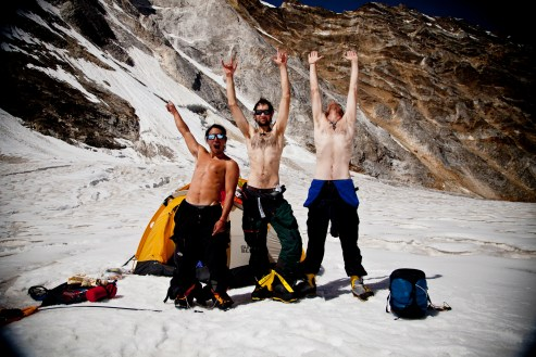 Jimmy Chin, Renan Ozturk and Conrad Anker rejoice after 12 days on the route. The descent is often the most dangerous part of climb. After two days of rappelling through severely overhanging rock, down rock strafed gullies and the final lower alpine ice wall, the team is finally able to take in their accomplishment.