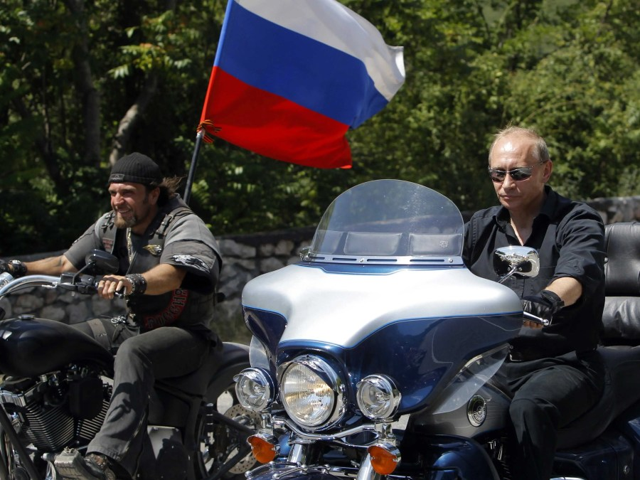 Here's Putin riding a Harley Davidson to a meeting with motorcycle enthusiasts in Crimea in 2010.
