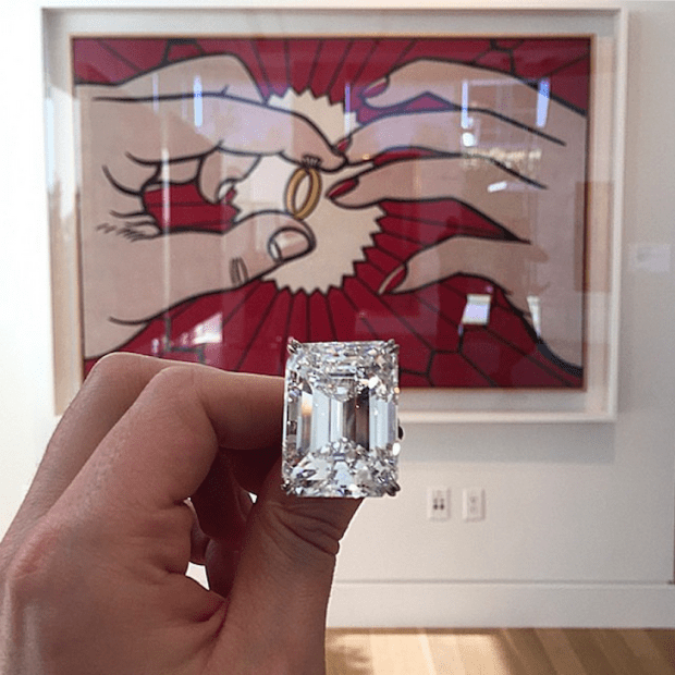 Which is worth more: the 100-carat diamond or the Lichtenstein painting in the background?