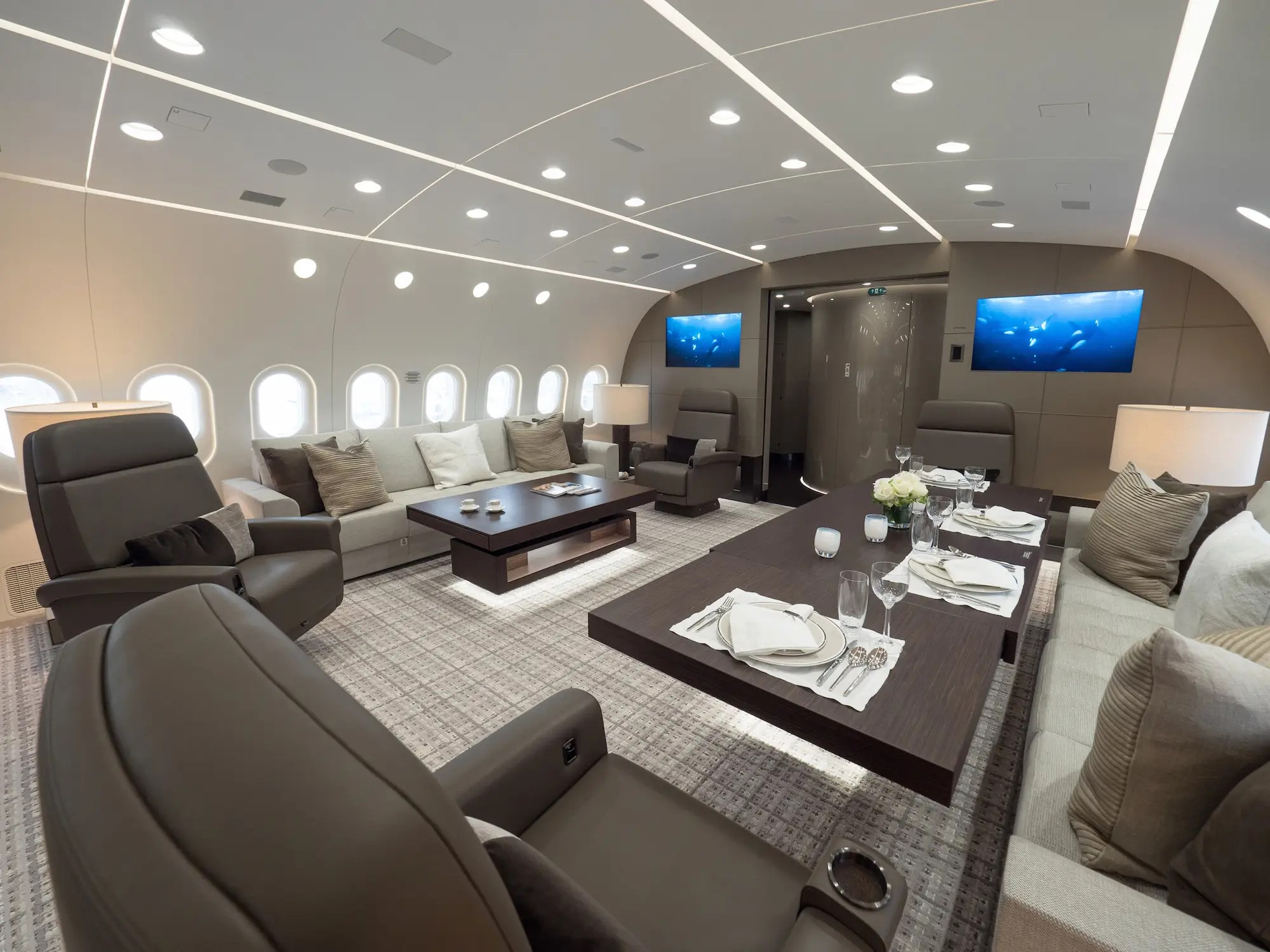 Looking towards the back of the plane, are a pair of divans that can be turned into sleeping accommodations or used as a dining and meeting area. Also located at the rear of the lounge are a pair of 47-inch screens. A stylish round VIP lavatory is located just aft of the lounge.