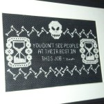 "Alex says, ""This is my discworld inspired cross stitch,  with a quote from death. """