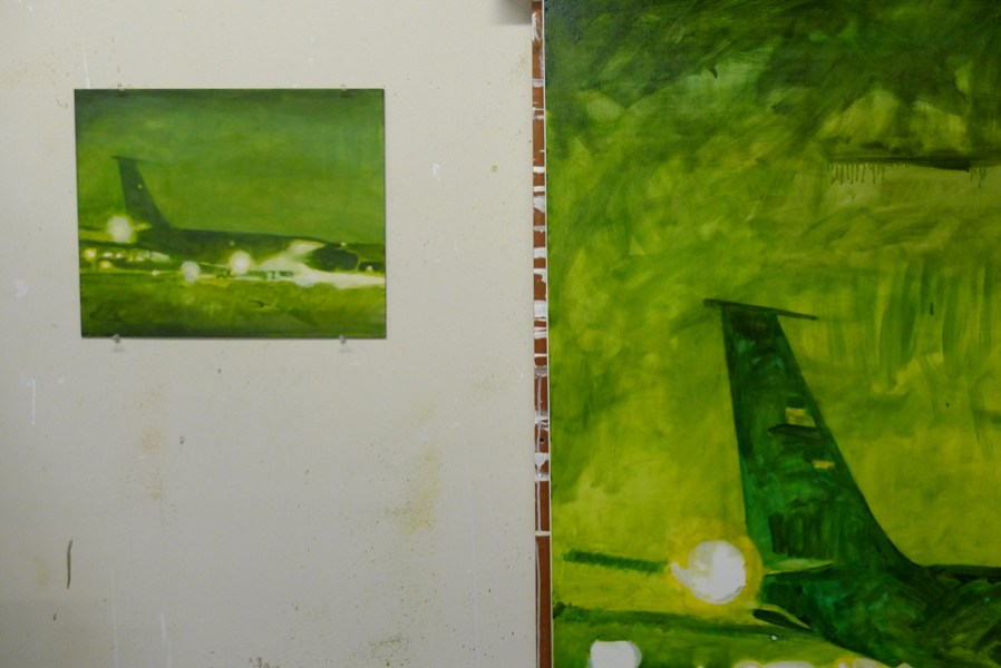 Aircraft painting in progress with small study