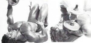 Arnold Schwarzenegger doing cross chest dumbbell tricep extension