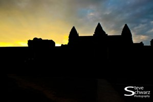 Sunset behind the towers of Angkor Wat