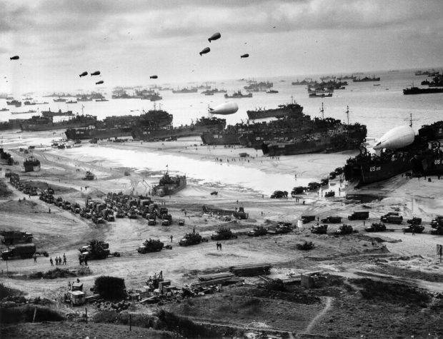 Unloading men, equipment & supplies on the beaches of Normandy after a beachhead was secured
