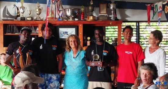 Lady Janice Compton (centre) presents the Sir John Compton Memorial Trophy to skipper Fredric Sweeney (2nd right) and the winning crew of Sugar Beach  Attitude. Far right: SLYC Vice Commodore Lily Bergasse.