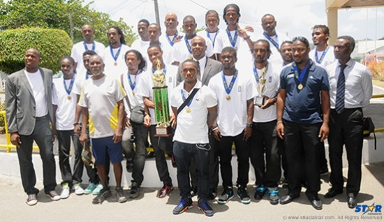 Minister of Youth Development and Sports Shawn Edward (centre) with the triumphant St Lucia National Football Team.