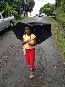 Let the four winds blow. Though her  umbrella-ella-ella be battered, this little girl's spirits remained high on Saturday.