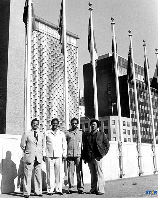 """""""If Tommy Tucker could sing for his supper, then who am I?"""" said foreign minister George Odlum (second from left) before a group of white journalists at a tax-funded luncheon at the Bibliotheque restaurant, next door to the UN Building in New York. Also pictured: Julian Hunte, Peter Josie and Rick Wayne."""