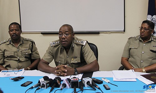 Errol Alexander (Center) flanked by RSLPF top brass at a press conference Friday.