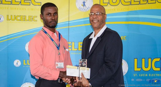 LUCELEC 2014 Employee of the Year Moses Montoute receiving his award from LUCELEC Managing Director Trevor Louisy.