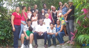 Dunstan St. Omer surrounded by his family and friends.