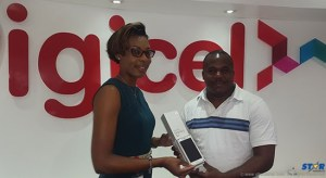 Digicel's Louise Victor presents Aaron Moses with his brand new S6.