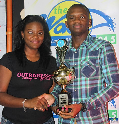 Masana of The WAVE presenting Private 6 with his trophy.