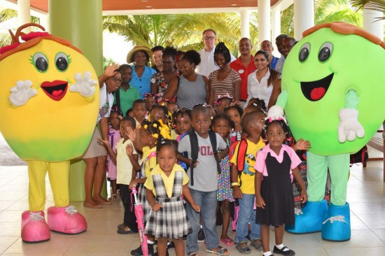 pre-schoolers with teachers, hotel staff and Coconut Bay mascots.