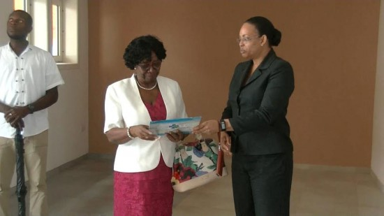 Governor General Dame Pearlette Louisy (left) being presented with a copy of the 2016 Millennium Heights Medical Complex Calendar by Permanent Secretary in the Ministry of Health, Conitha Thomas.