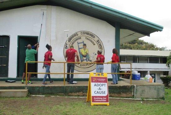 Volunteers engaged in painting the school.