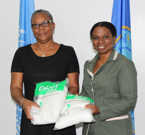 Valerie Beach-Horne, PAHO's Country Programme Specialist (left) and Chief Medical Officer Dr. Merlene Fredericks with some of the donations.