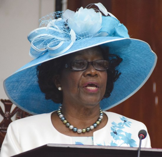 Dame Pearlette Louisy delivering the throne speech at the opening of the first session of the 11th parliament of Saint Lucia: She hasn't looked as happy since 1998!