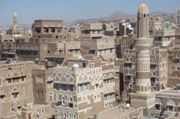 This city in Yemen, Saana, is similar in architecture with the painting, below, of a town in Saudi Arabia.
