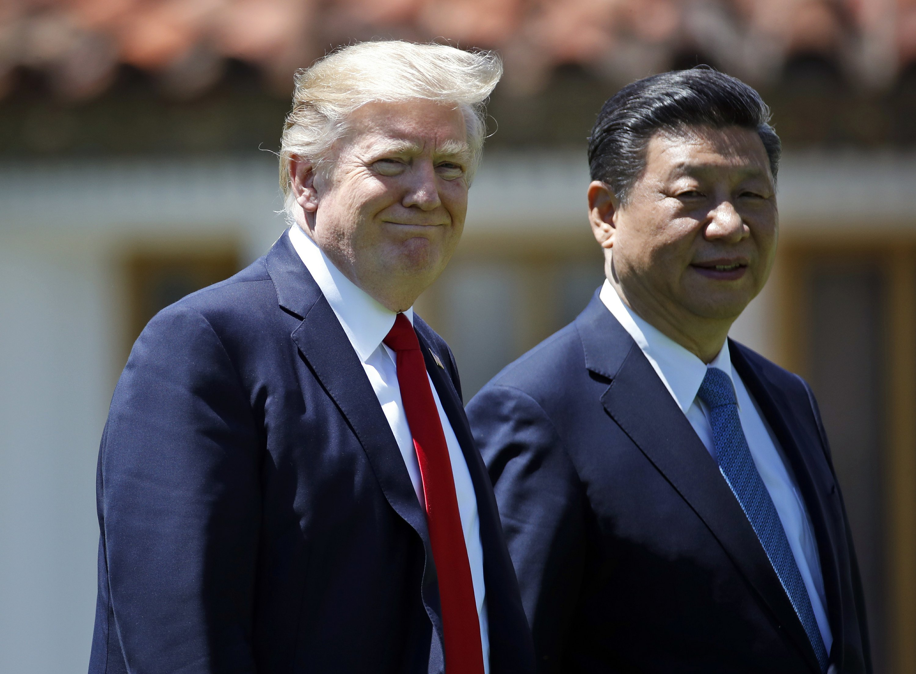 china s xi urges trump to show restraint on north korea 2