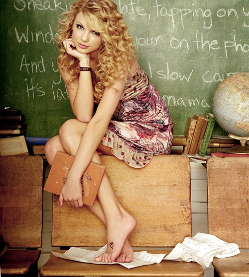 "In ""Our Song,"" Swift asks god to give her a ""song"" made up of sounds from her everyday life; in the promotional art, this becomes a serious of words on a classroom chalkboard."