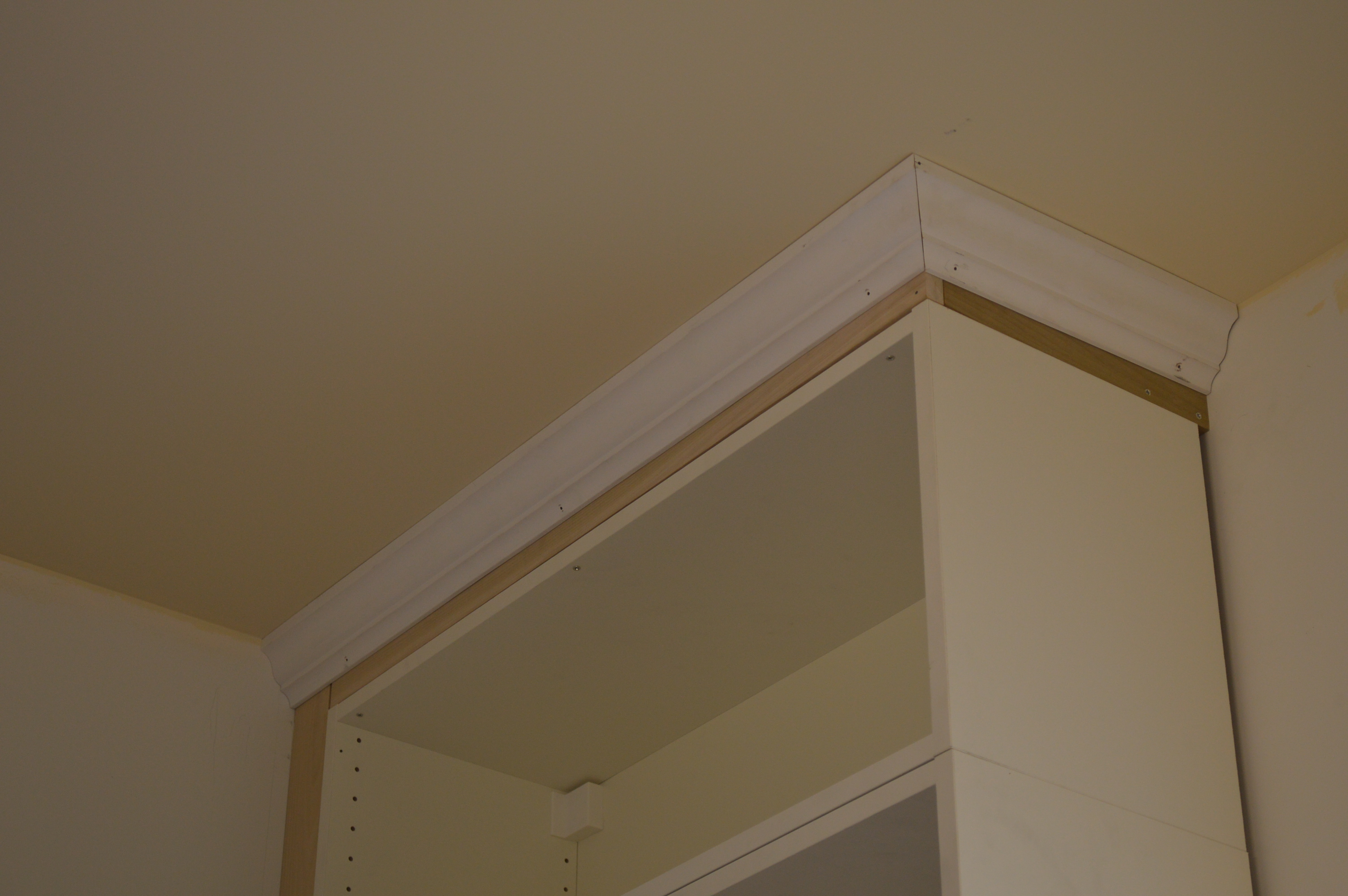 Cabinets got crowned st paul haus for Adding crown molding to kitchen cabinets before after
