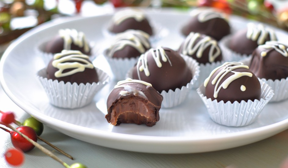 Irrisistible chocolate truffles - one with a bite out