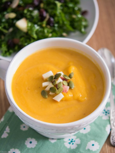 Butternut Squash & Celeriac Soup garnished with chopped apple & pumpkin seeds.