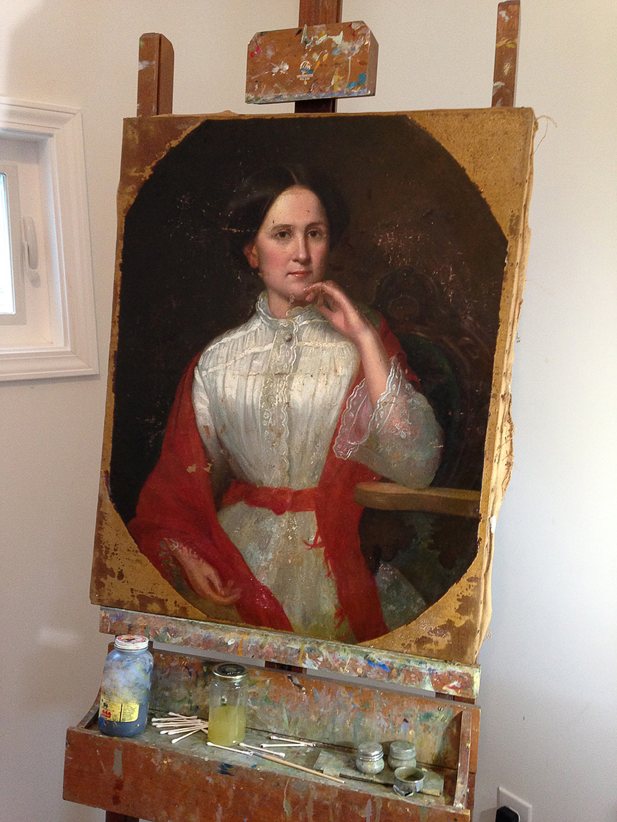 Painting Restoration on easel ready for in-painting