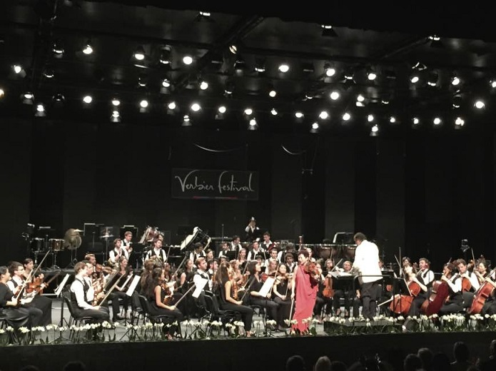 Violinist Kyung Wha Chung, Charles Dutoit, and the Verbier Festival Orchestra after playing the Brahms Violin Concerto.