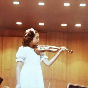 Anne Akiko Meyers as a child and onstage with the Los Angeles Philharmonic