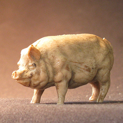 Violin maker James N. McKean's toy pig named Arnold, found at Peter Prier school