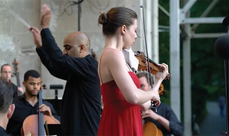 Violinist Tessa Lark performs John Corigliano's the Red Violin: Suite in Central Park, New York